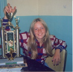 Sharron,age 15, with floor hockey trophy from Boys and Girls Club / à l'âge de 15 ans, posant ici avec son trophee.
